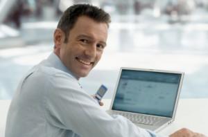 businessman-with-laptop-FB-Crop-300x198